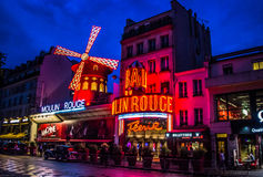 The Moulin Rouge by night. Night lights of the Moulin Rouge cabaret in Paris royalty free stock photo