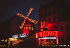 The Moulin Rouge by night. Stock Photo