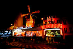 The Moulin Rouge by night in Paris, France Royalty Free Stock Images