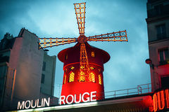 The Moulin Rouge by night Stock Photography