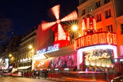 The Moulin Rouge , Paris, France. It is a famous cabaret built in 1889, locating in the Paris red-light district of. PARIS - February 17, 2018 : The Moulin Rouge royalty free stock photography
