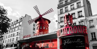 Moulin Rouge in Paris. Paris, France - May 18, 2014: Moulin Rouge on a black and white rendition with red selective color stock images