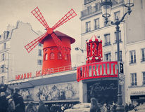 The Moulin Rouge with retro vintage Instagram style filter effe. Ct. Moulin Rouge is a famous cabaret built in 1889, locating in the Paris red-light district of Stock Image