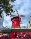 Moulin Rouge windmill against a cloudy summer sky, Paris Royalty Free Stock Image
