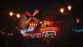 The Moulin Rouge windmill,is a famous cabaret built in 1889. PARIS - May 20: The Moulin Rouge windmill, on May 20, 2016 in Paris, France. Moulin Rouge is a Stock Photo