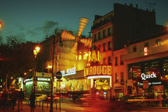 The Moulin Rouge windmill,is a famous cabaret built in 1889. PARIS - May 20: The Moulin Rouge windmill, on May 20, 2016 in Paris, France. Moulin Rouge is a Stock Images