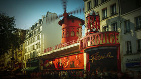 The Moulin Rouge windmill,is a famous cabaret built in 1889. PARIS - May 20: The Moulin Rouge windmill, on May 20, 2016 in Paris, France. Moulin Rouge is a Stock Photography