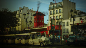 The Moulin Rouge windmill,is a famous cabaret built in 1889. PARIS - May 20: The Moulin Rouge windmill, on May 20, 2016 in Paris, France. Moulin Rouge is a Stock Photos