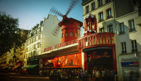 The Moulin Rouge windmill,is a famous cabaret built in 1889. PARIS - May 20: The Moulin Rouge windmill, on May 20, 2016 in Paris, France. Moulin Rouge is a Royalty Free Stock Images