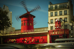 The Moulin Rouge windmill,is a famous cabaret built in 1889. PARIS - May 20: The Moulin Rouge windmill, on May 20, 2016 in Paris, France. Moulin Rouge is a Stock Image