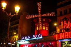Moulin Rouge is the world famous cabaret in Paris at Montmartre. A very effective night light and rotating blades of the windmill stock images
