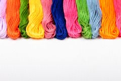 Mouline. Colorful cotton craft threads on white canvas with copy space Stock Photo