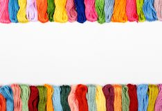 Mouline. Colorful cotton craft threads on white canvas with copy space Stock Images