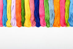 Mouline. Colorful cotton craft threads on white canvas with copy space Stock Photos