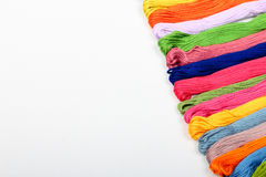 Mouline. Colorful cotton craft threads on white canvas with copy space Royalty Free Stock Images