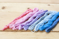 Mouline, embroidery thread on light wooden table. Selective focus Royalty Free Stock Photography