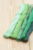 Mouline, embroidery thread on light wooden table. Selective focus Royalty Free Stock Photo