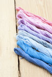 Mouline, embroidery thread on light wooden table. Selective focus Royalty Free Stock Photos