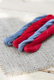 Mouline, embroidery thread on a napkin of burlap. Selective focus Royalty Free Stock Image