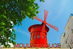 Mouline Rouge Cancan Dance Club. Nightclub for cancan dancers in the Montmartre district of Paris. The iconic red windmill beacons visitors to come in Royalty Free Stock Photo
