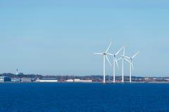 Moulins à vent en mer Photographie stock libre de droits