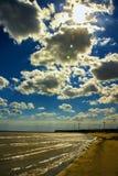 Moulins à vent en mer Photographie stock
