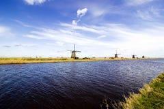 Moulins à vent par la rivière photo libre de droits