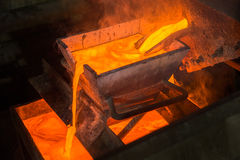 Moulting Gold an einer Fabrik Stockfotografie