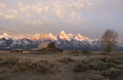 Moulton barn with Tetons in the background on Mormon Row Royalty Free Stock Images