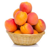 Mound of apricots in a basket Stock Photo