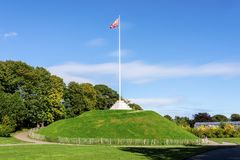 The Mound artificial hill wiith a tall flagpole in Duthie Park, Aberdeen royalty free stock photo