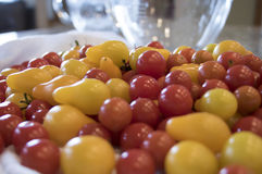 Mound of Cherry Tomatoes on Kitchen Counter Royalty Free Stock Images