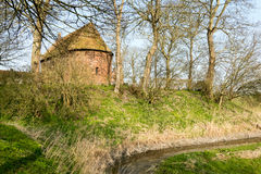 Mound with a church. Royalty Free Stock Images