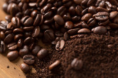 Mound of Coffee Beans and Grounds Royalty Free Stock Photos