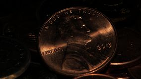 Mound of coins. Coin two cents. Close up. Coins in a dark room shines from them falling on the light, coin in denomination of two cents you can see when lighting stock video footage