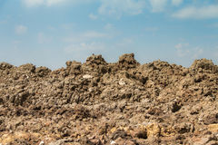 Mound of earthwith blue sky Royalty Free Stock Photography