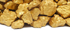 Mound of gold. Close-up isolated on white background Royalty Free Stock Photos