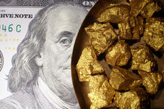 Mound gold and dollar bills stock photography