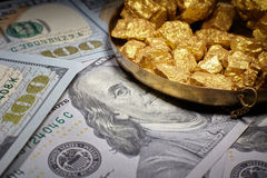 Mound gold and dollar bills royalty free stock images