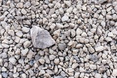 Mound of granite gravel, stones, crushed stone close-up. Rough seamless texture, construction material background.  stock image