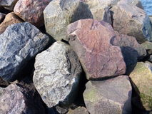 The mound of large stones on the coast near the sea Royalty Free Stock Photography