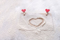 On the mound painted heart, imitation snow, Valentine`s day, people`s attitudes Stock Photography