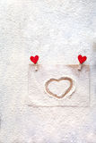 On the mound painted heart, imitation snow, Valentine`s day, people`s attitudes Royalty Free Stock Photography