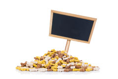 Mound of pet food and placard Royalty Free Stock Images