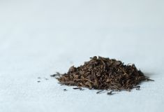 Mound of tea. Mound of loose Earl Gray tea on blue cloth Stock Photography