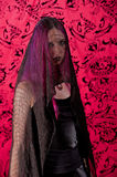 Mounring woman in black. A beautiful young woman with pink hair mourns her loss as she is shrouded in black Stock Images