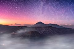 Mount active volcano, Batok, Bromo, Semeru with starry and fog a. T dawn. Bromo Tengger Semeru National Park, East Java, Indonesia royalty free stock images