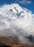 Mount Ama Dablam within clouds, way to Everest base camp Royalty Free Stock Photos