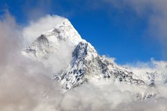 Mount Ama Dablam within clouds, way to Everest base camp. Khumbu valley, Sagarmatha national park, Everest area, Nepal royalty free stock images