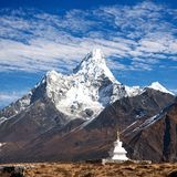Mount Ama Dablam with stupa near Pangboche village. And beautiful cloudy sky - way to mount Everest base camp - Khumbu valley - Nepal Royalty Free Stock Photos